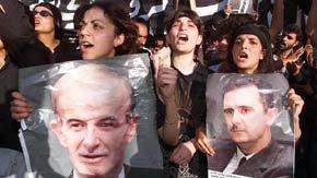 Manifestantes en apoyo al presidente sirio