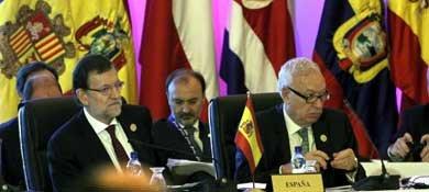 El presidente del Gobierno, Mariano Rajoy, y el ministro de Asuntos Exteriores, José Manuel Gacía-Margallo. (Efe)