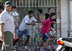Al menos 60 heridos y 18 detenidos en los saqueos en la ciudad argentina de Córdoba