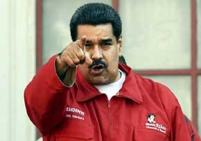 El presidente venezolano Nicolás Maduro gesticula durante una marcha con trabajadores de PDVSA en Caracas el 12 de enero de 2016 (AFP/JUAN BARRETO)