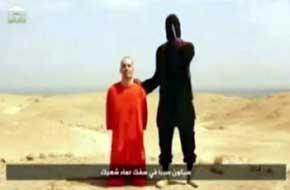 Imagen de uno del los v�deos en el que 'Yihadi John' decapita a un reh�n
