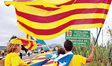 Parlamento de Catalu�a desaf�a a la justicia y aprueba texto que los