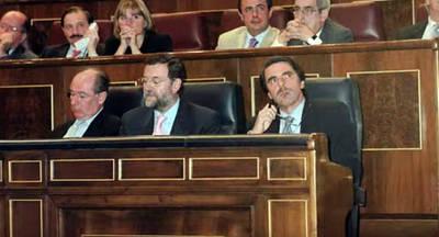 Rodrigo Rato, Mariano Rajoy y José María Aznar en una foto de archivo