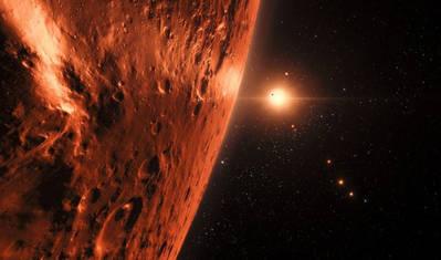 Ilustración de la estrella enana TRAPPIST-1 y sus siete planetas vistos desde uno de ellos