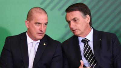 Jair Bolsonaro (d) junto a Onyx Lorenzoni, ministro jefe de la Casa Civil