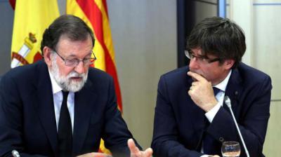 mariano Rajoy (i) y Carles Puigdemont en imagen de archivo