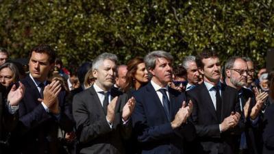 Casado, Garrido, Marlaska y Rivera durante un homenaje por los 15 años del 11M.