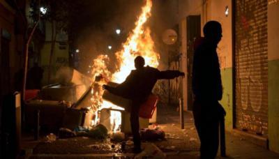 Violentos disturbios en Madrid por la muerte de un vendedor ambulante