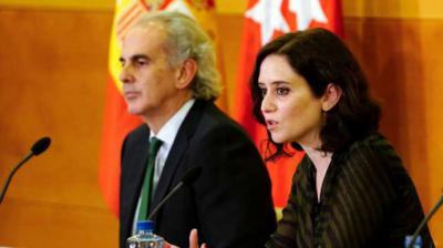 El consejero de Sanidad de la Comunidad de Madrid, Enrique Ruiz Escudero, y la presidenta madrileña, Isabel Díaz Ayuso.