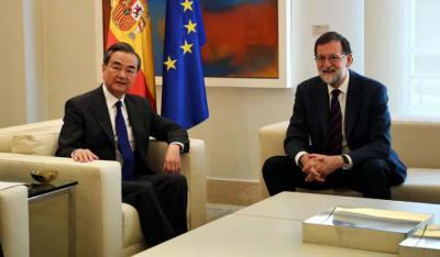 Wang Yi y Mariano Rajoy