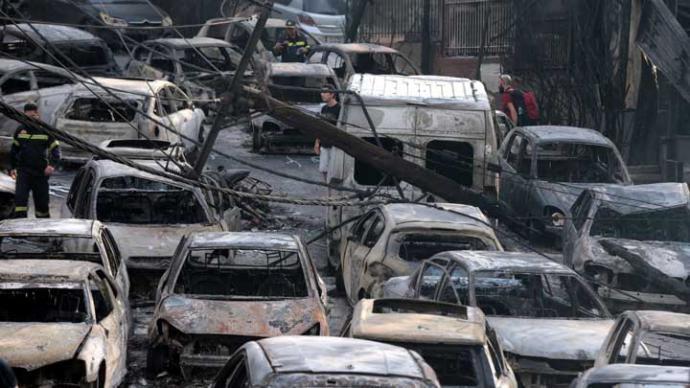 Autoridades griegas temen que el número de víctimas por el incendio ascienda el centenar