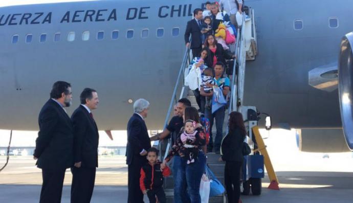 Casi 100 chilenos regresan a su país escapando de la crisis en Venezuela. (Presidencia de Chile)