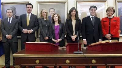 Edelmira Barreira, entre la vicepresidenta Soraya Sáez de Santamaría y el exministro José Manuel Soria