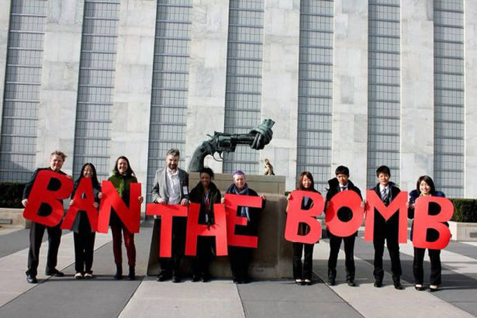 "A ""ban the bomb"" sign outside of the United Nations headquarters in New York City"