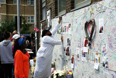 Wall of tributes to the casualties of the Grenfell Tower fire in Bramley Road, London